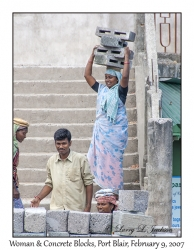 Woman carrying Concrete Blocks